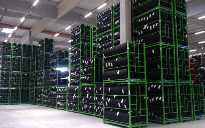 View of mutliple rows of high-rack shelves filled with tyres at a warehouse.