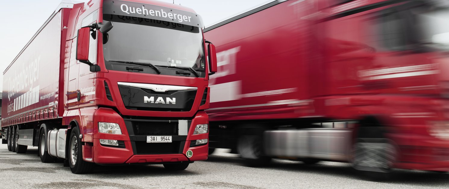 Two Quehenberger trucks on the road.