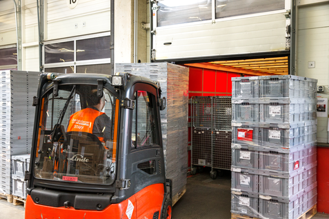 Forklift stacking parcels.